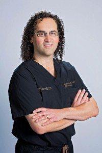 Dr. Jon Mendelsohn in scrubs