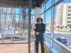Dr. Mendelsohn standing in the new StudioA office set to open March 2019